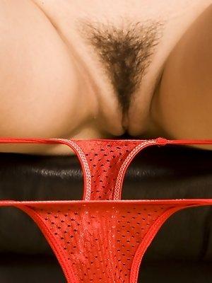Sasha Grey strikes a few dramatic and sensually erotic poses for an art gallery photo shoot.